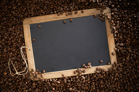 Photo for Vintage school slate surrounded by roast coffee beans with the copy space on the chalk board - Royalty Free Image