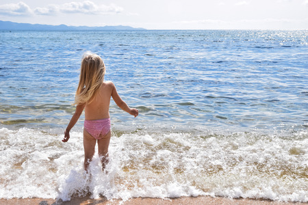 Photo for Little girl on the sunny coast - Royalty Free Image