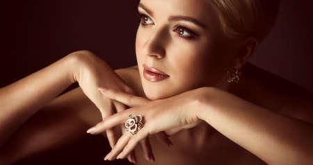Foto de Portrait of beautiful young woman with makeup in luxury jewelry - Imagen libre de derechos