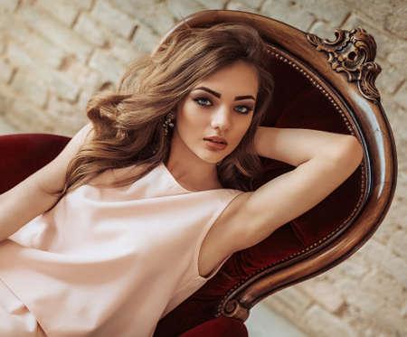 Photo pour Portrait of beautiful young woman with makeup in fashion clothes - image libre de droit