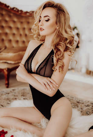Photo for Sexy beautiful blonde girl in black underclothes - Royalty Free Image