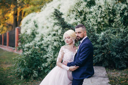 Photo for Happy bride and groom on their wedding in garden - Royalty Free Image