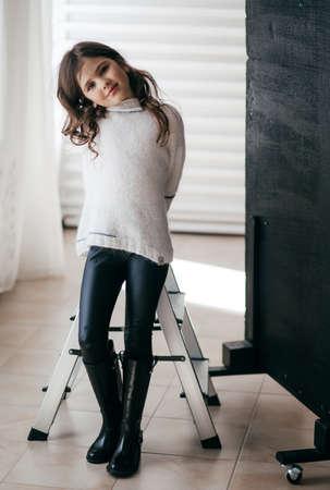 Photo pour Portrait of beautiful little girl with pigtails - image libre de droit