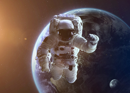 Colorful shot that shows NASA\'s astronaut in open space near planet Earth.