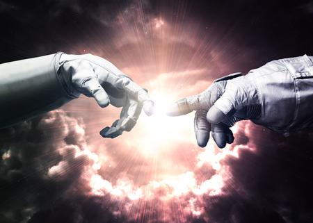 Foto de Michelangelo God\'s touch. Close up of human hands touching with fingers in space.  - Imagen libre de derechos