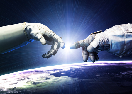 Photo pour Michelangelo God\'s touch. Close up of human hands touching with fingers in space.  - image libre de droit