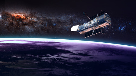 Photo pour The Hubble Space Telescope in orbit above the Earth. Elements of this image furnished by NASA. - image libre de droit