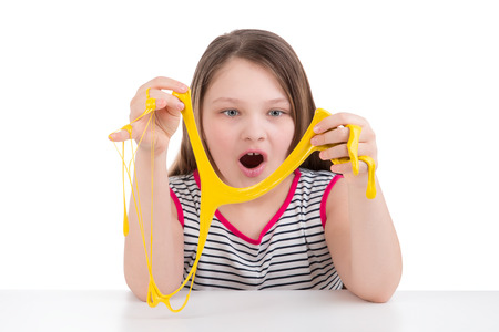 Photo for Girl playing with mucus on white background - Royalty Free Image