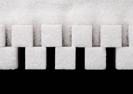 Photo for Sugar cubes and sugar sand close up. - Royalty Free Image