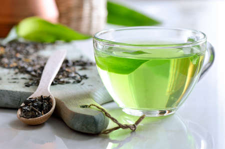 Photo for Green spa tea in a glass cup, detox and relaxing warm drink - Royalty Free Image