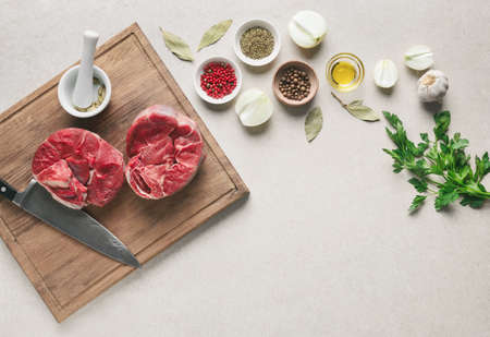 Photo for Beef stew ingredients on a kitchen table, blank space for a text, overhead view, flat lay arrangement - Royalty Free Image