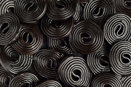 Foto de Licorice wheels candies. Candy flavored licorice. Top View - Imagen libre de derechos