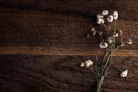 Foto de Bouquet of dried flowers on a wooden background. - Imagen libre de derechos