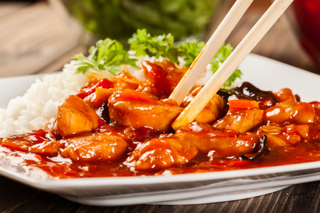 Photo for Sweet and sour chicken with rice on a plate - Royalty Free Image