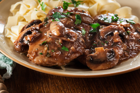 Photo for Delicious chicken marsala served with fettucine pasta. Italian cuisine - Royalty Free Image