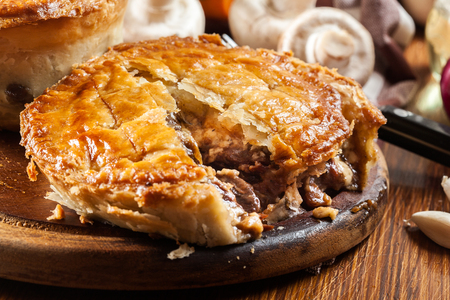 Photo for Fresh beef stew pie on a cutting board. Meat in puff pastry - Royalty Free Image