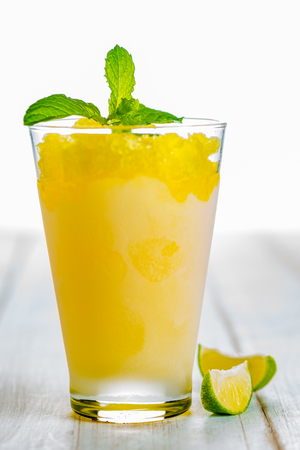 Photo for Lemon refreshing dessert in glass decorated with lemon and mint on white wood table - Royalty Free Image