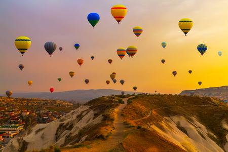 Photo for Hot air balloons landing in a mountain Cappadocia Goreme National Park Turkey. - Royalty Free Image