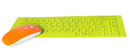 Photo for orange computer mouse water droplets on green button key of keyboard isolated on the white background - Royalty Free Image