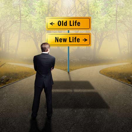 Foto de man has to decide to go on the old or the new way of life - Imagen libre de derechos