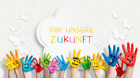 Photo for colorful painted hands in front of a decorated wall with the sentence For our future in German - Royalty Free Image