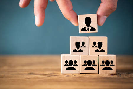 Photo pour organization and team structure symbolized with cubes - image libre de droit