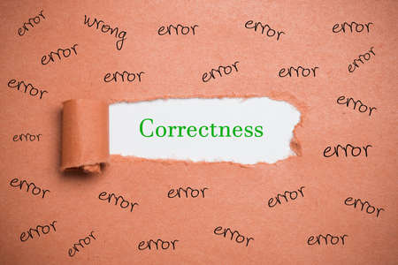 Photo for torn paper revealing the word Correctness surrounded by the word error - Royalty Free Image
