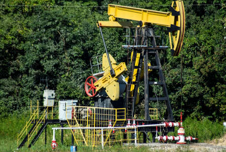 Photo pour The pumping unit as the oil pump installed on a well. Equipment of oil fields. - image libre de droit