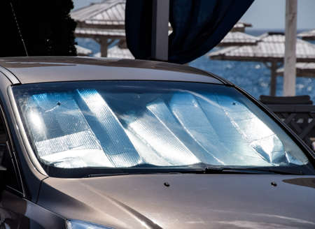 Foto de Protection of the car panel from direct sunlight. Sun Reflector windscreen. - Imagen libre de derechos