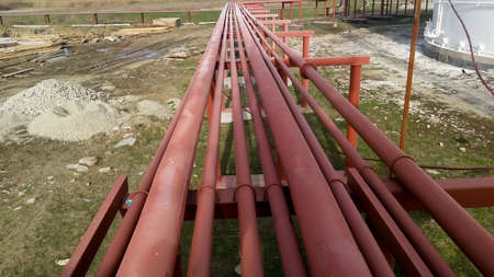 Photo pour Piping for pumping refined petroleum products. Pipes at the refinery. - image libre de droit