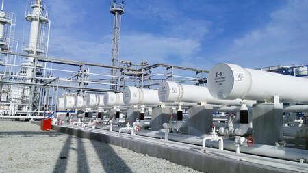 Photo pour Heat exchangers in a refinery. The equipment for oil refining. - image libre de droit