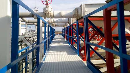 Photo pour Steel service platform and stairs. Equipment refinery. - image libre de droit