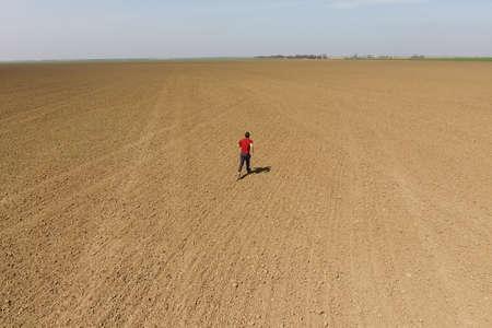 Foto per A man runs across the field. Jogging in the open field. - Immagine Royalty Free
