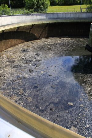 Foto de Mud formation in the secondary clarifier of a sewage treatment plant, which was emptied for inspection work - Imagen libre de derechos