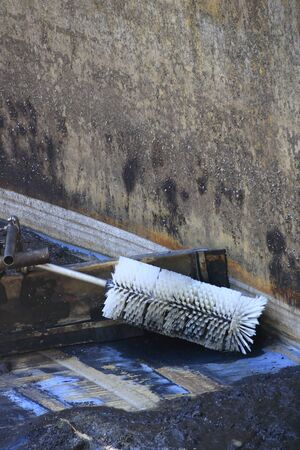 Foto de Brush for gutter cleaning has wedged in the sludge remover in a secondary clarifier in a sewage treatment plant - Imagen libre de derechos