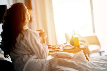 Foto de Breakfast in bed, cozy hotel room. concept - Imagen libre de derechos