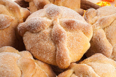 Photo for Sweet bread called Bread of the Dead (Pan de Muerto) enjoyed during Day of the Dead festivities in Mexico. - Royalty Free Image
