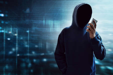 Foto de Hacker using mobile phone - Imagen libre de derechos