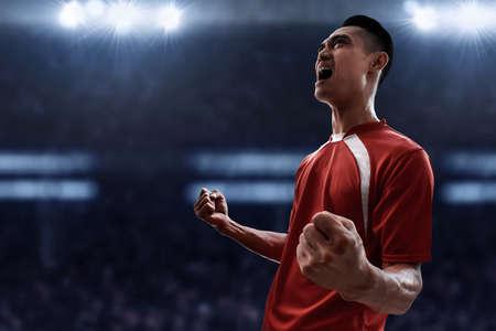 Photo pour Asian soccer player celebrating - image libre de droit