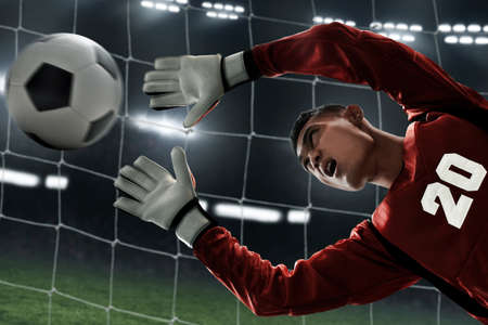 Photo pour Soccer goalkeeper catches the ball - image libre de droit