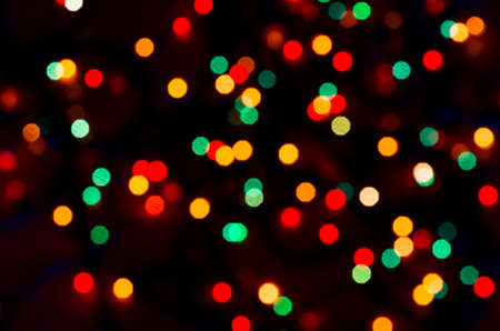 Foto de Colorful beautiful multi-colored Christmas lights on a black background - Imagen libre de derechos