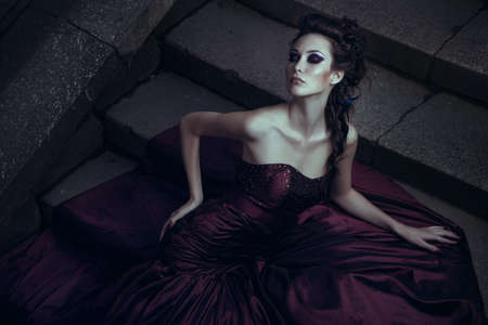 Photo for Beautiful woman in violet dress - Royalty Free Image
