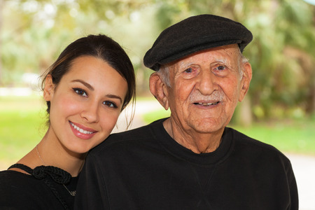 Photo pour Elderly eighty plus year old man with granddaughter in a outdoor setting. - image libre de droit