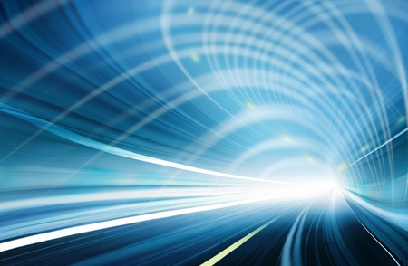 Abstract speed motion in blue highway road tunnel