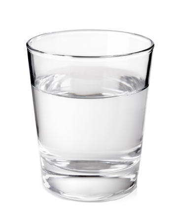 Foto de Transparent glass with clean mineral water isolated on white background - Imagen libre de derechos