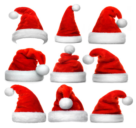 Foto de Set of red Santa Claus hats isolated on white background - Imagen libre de derechos