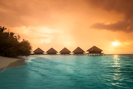 Photo for Over water bungalows with steps into amazing green lagoon - Royalty Free Image