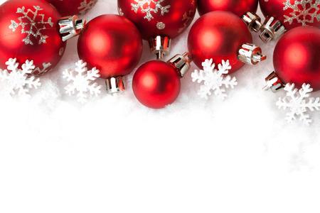 Photo pour red christmas balls in the snow on white. studio shot - image libre de droit
