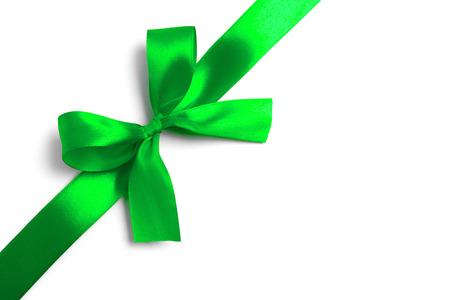 Photo pour Shiny green satin ribbon on white background. studio shot - image libre de droit