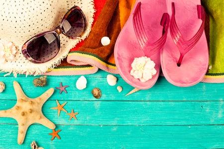 Photo pour Summer accessories on blue wooden background. studio shot - image libre de droit